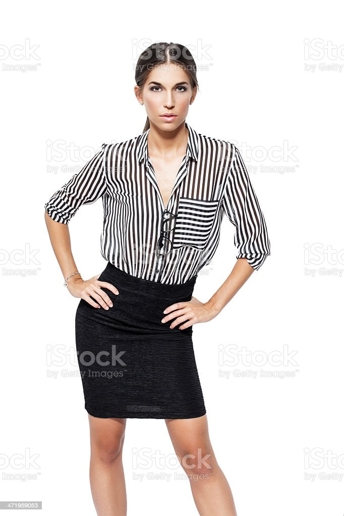 Confident businesswoman hands on waist isolated royalty-free stock photo