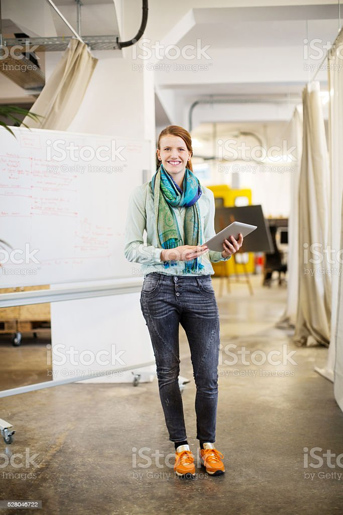 Confident businesswoman holding digital tablet stock photo