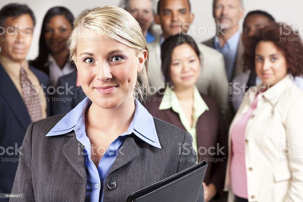 Confident businesswoman in front of diverse business team royalty-free stock photo