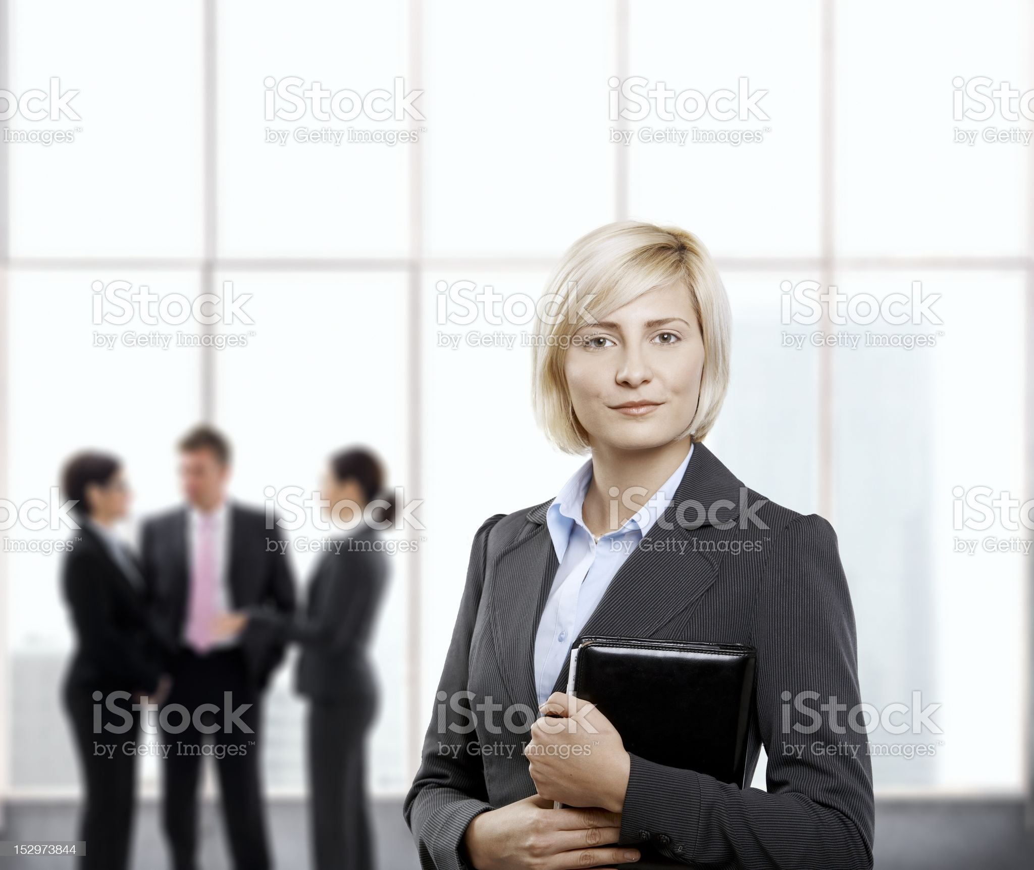 Confident businesswoman in office lobby royalty-free stock photo