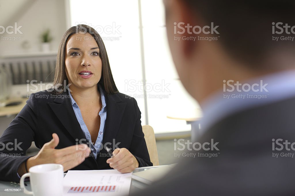 Confident businesswoman in office meeting stock photo