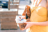 Confident  Businesswoman is taking out money from wallet