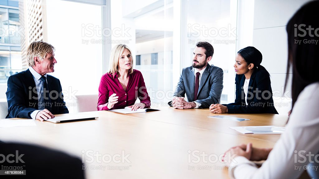 Confident businesswoman making her point in business meeting stock photo