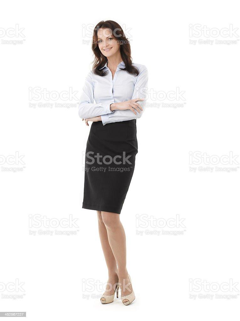 Confident Businesswoman On White Background stock photo