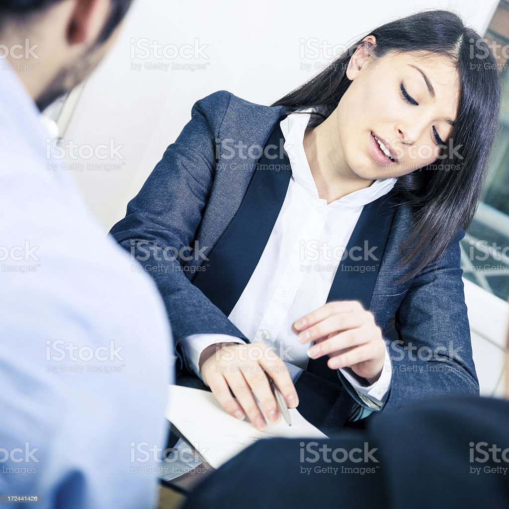 Confident businesswoman showing contracts royalty-free stock photo