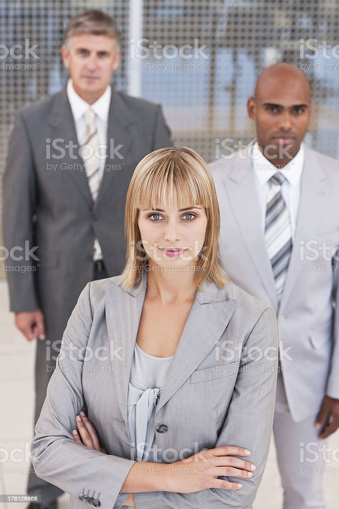 Confident businesswoman with colleagues in the background royalty-free stock photo