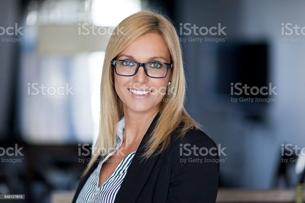 Confident Businesswoman Working At The Office stock photo