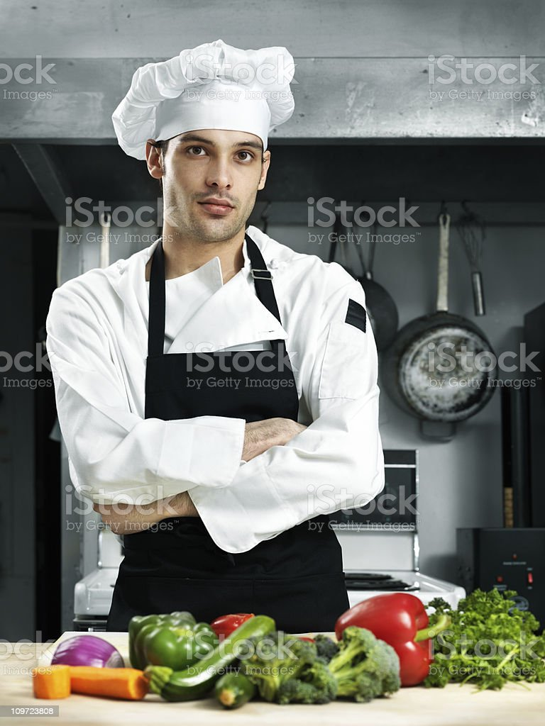 Confident chef in a kitchen stock photo