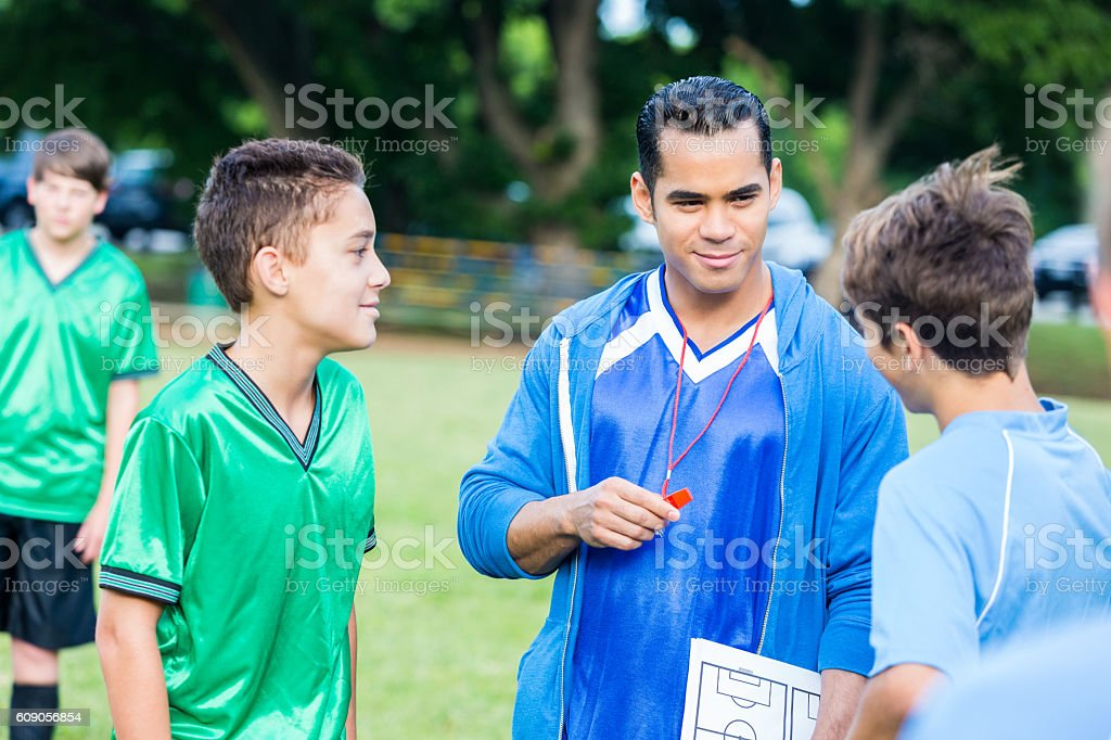 Confident coach talks with players before game stock photo