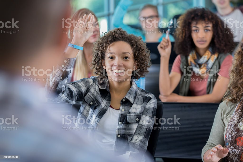 Confident college students answer question in class stock photo