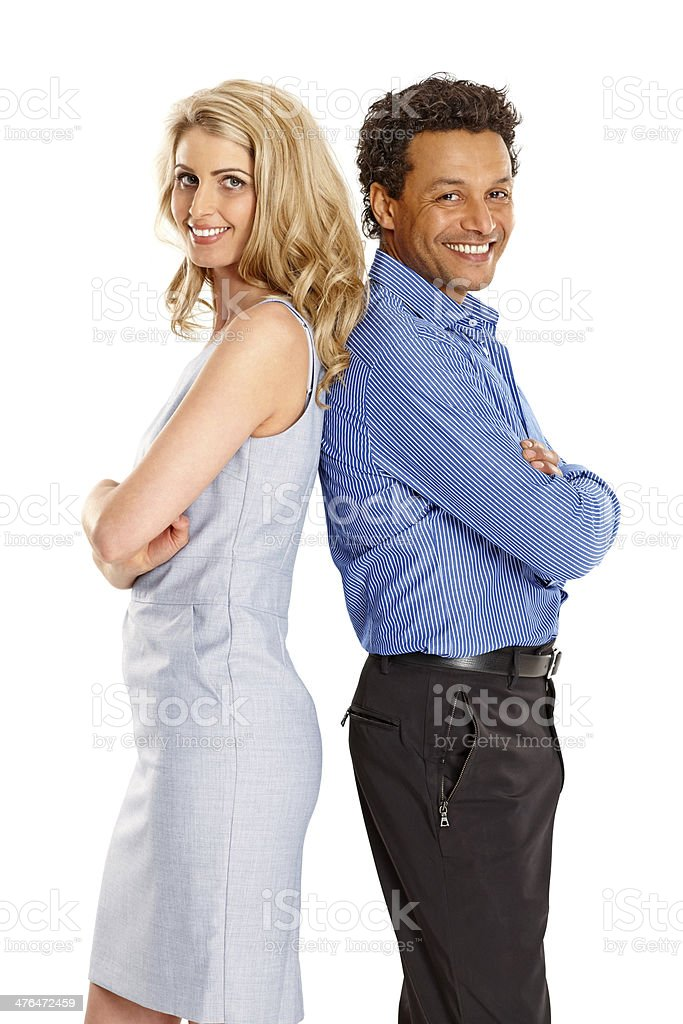 Confident couple standing against each other royalty-free stock photo