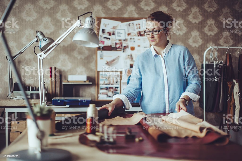 Confident craftswoman working in her workshop stock photo