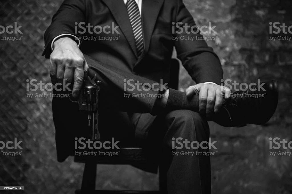 Confident crime lord showing who the boss is stock photo