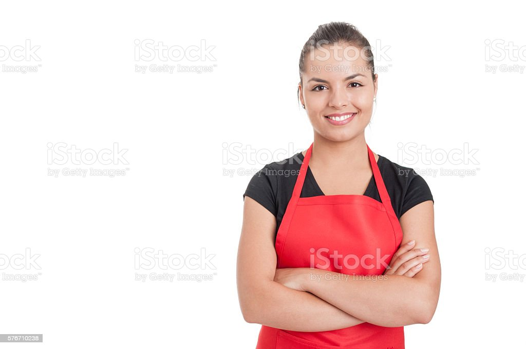 Confident cute employee standing with folded arms stock photo