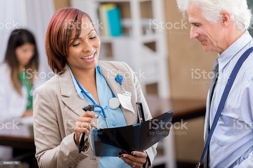 Confident diverse medical professionals review x-ray stock photo