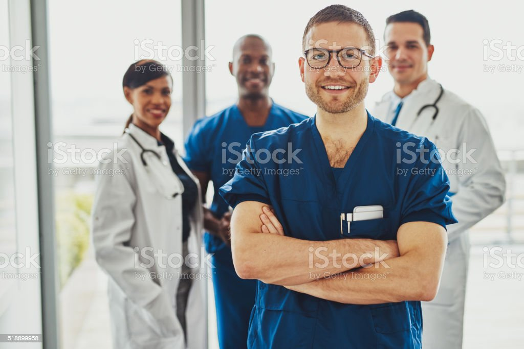 Confident doctor in front of group stock photo