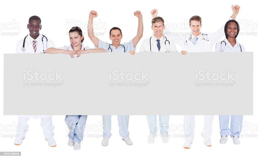 Confident Doctors Holding Blank Billboard stock photo