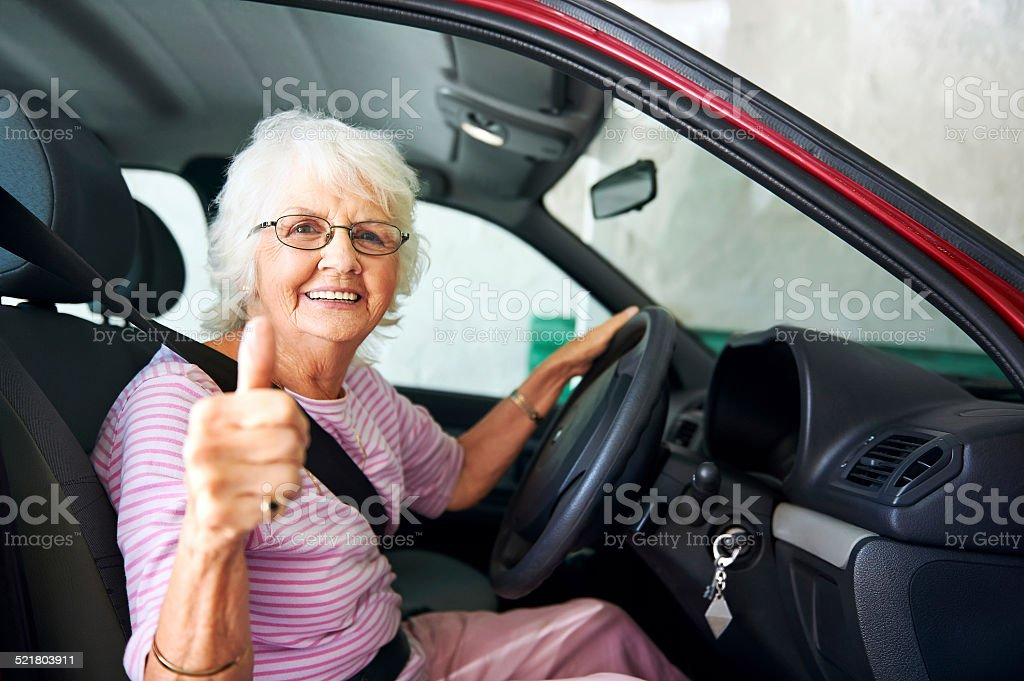 confident driving grandma stock photo