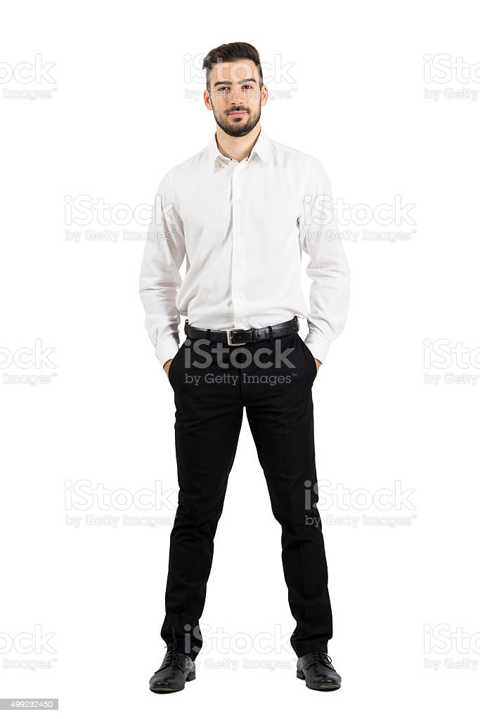 Confident elegant business man with hands in pockets stock photo