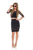 Confident Elegant Woman In Black Dress And Sunglasses
