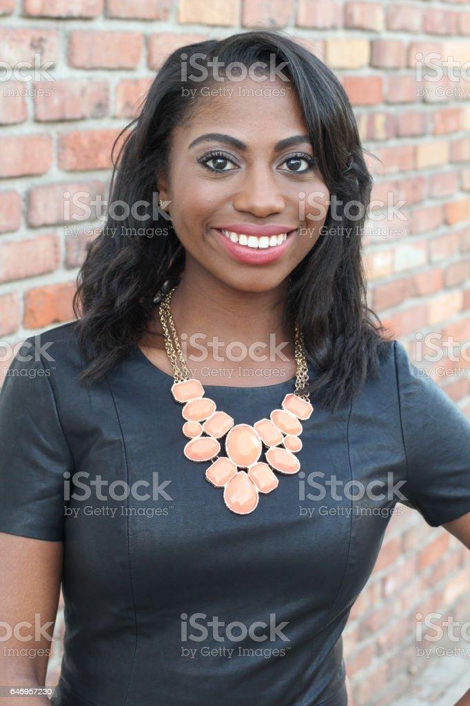 Confident elegant young black female stock photo