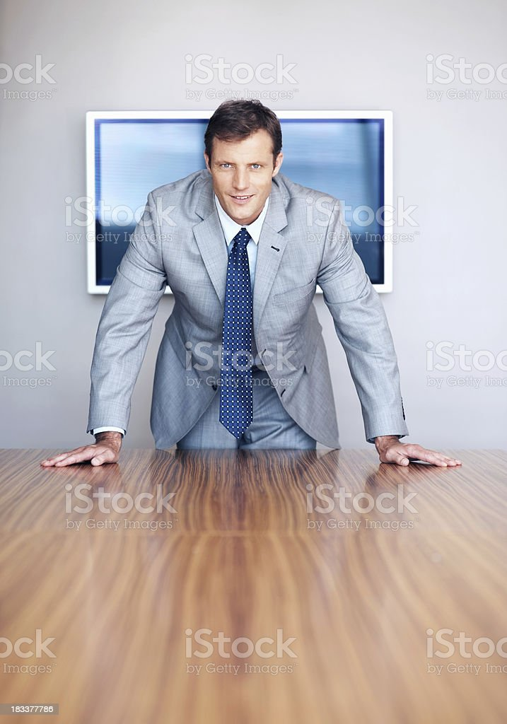 Confident executive commanding attention royalty-free stock photo