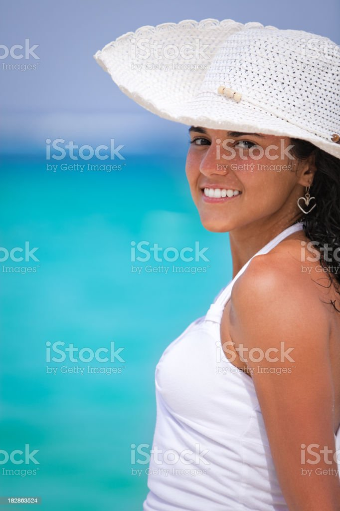Confident fashion young happy woman with white hat royalty-free stock photo