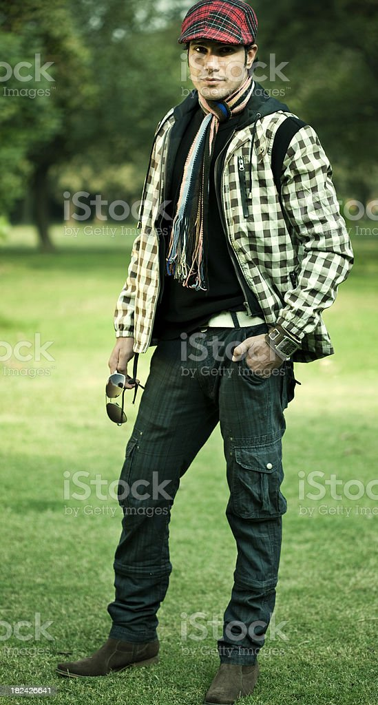 Confident, fashionable young man in natural environment royalty-free stock photo