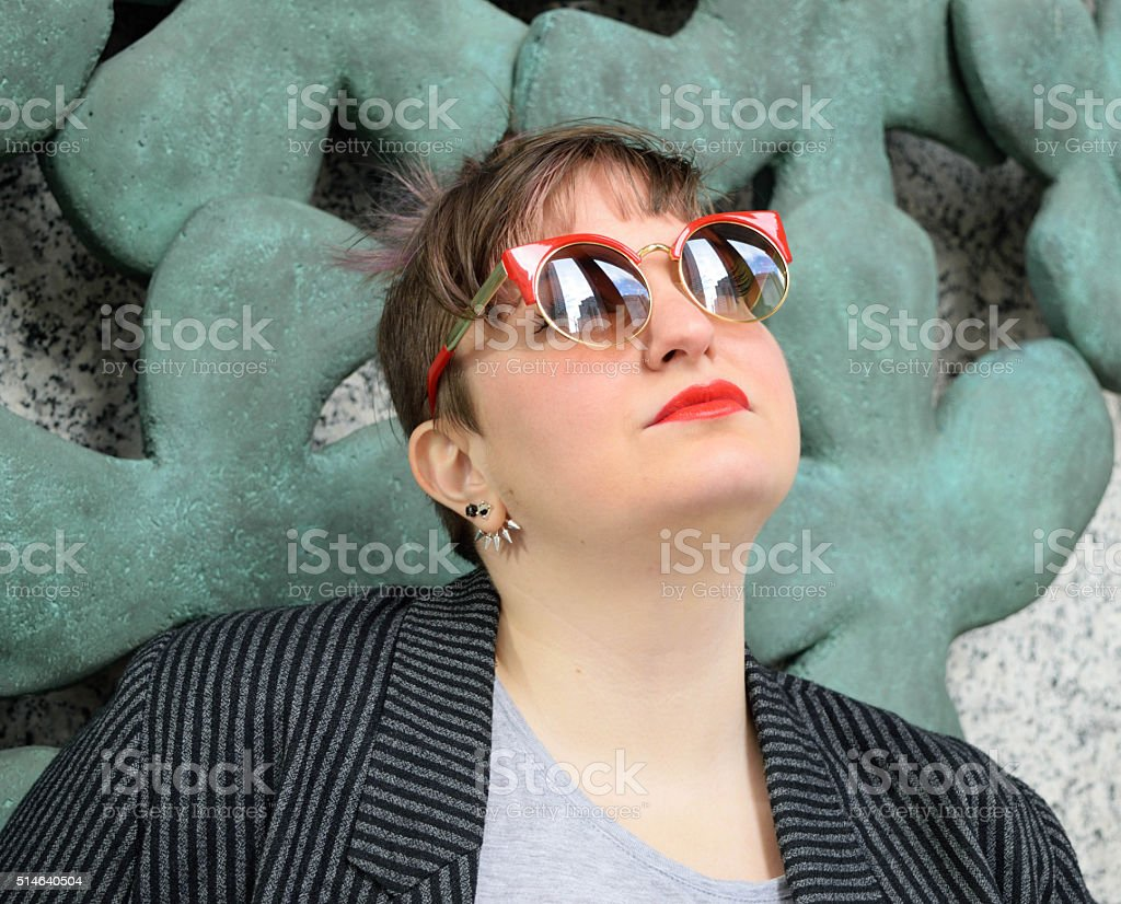 Confident Fashionable Young White Female Wearing Sunglasses stock photo