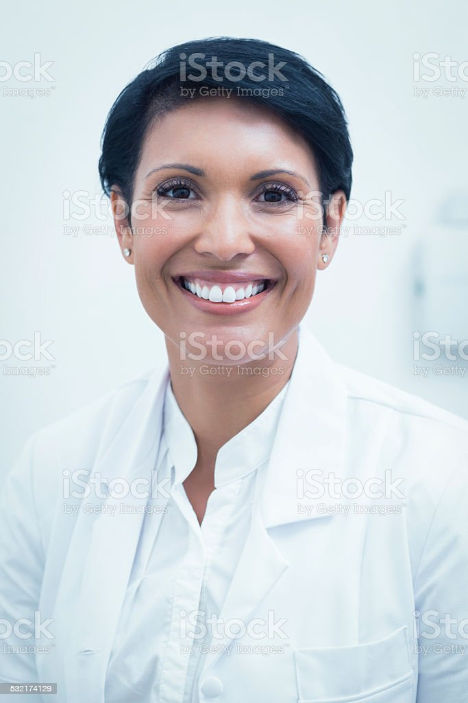 Confident female dentist smiling stock photo