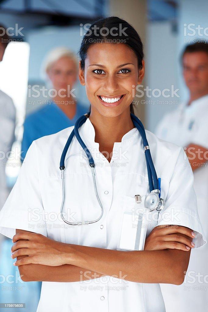 Confident female doctor leading her team stock photo