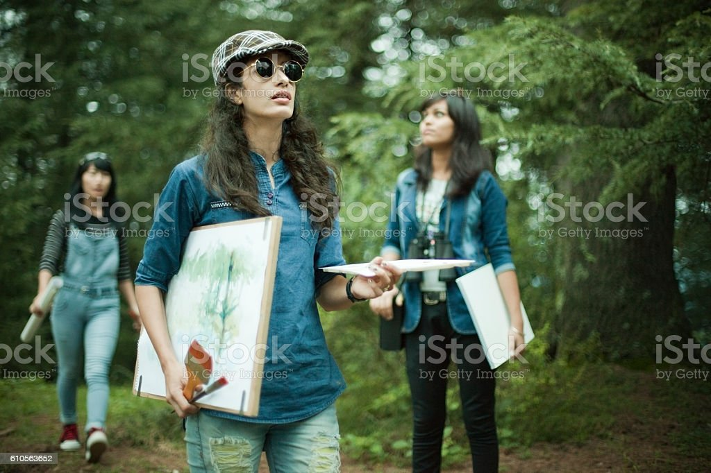 Confident, female fine art college students in outdoor location. stock photo