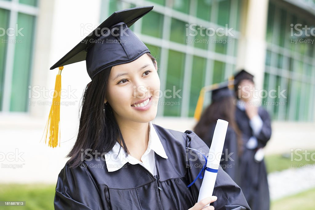Confident female graduate holding diploma royalty-free stock photo