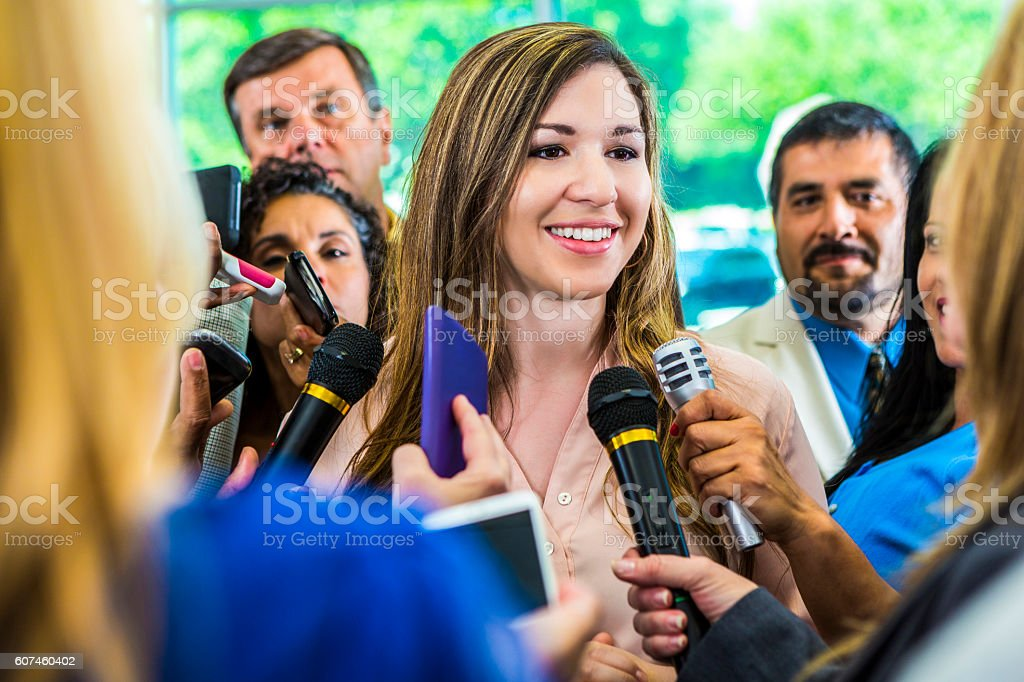 Confident female politician answers the media's questions stock photo