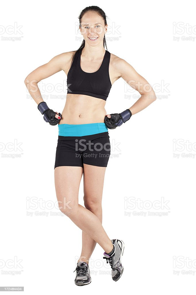 Confident fitness woman standing on white royalty-free stock photo