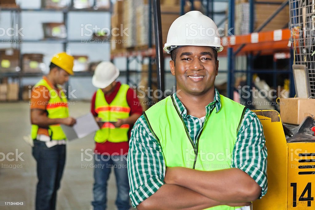 Confident forklift operator in shipping distribution warehouse royalty-free stock photo