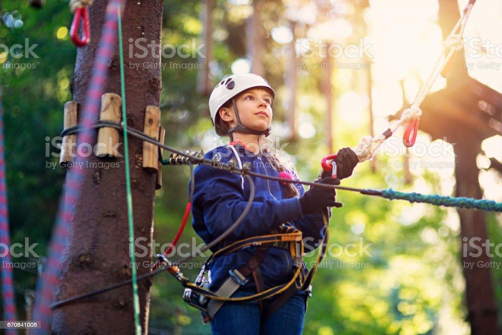 Confident girl having fun on canopy tour stock photo