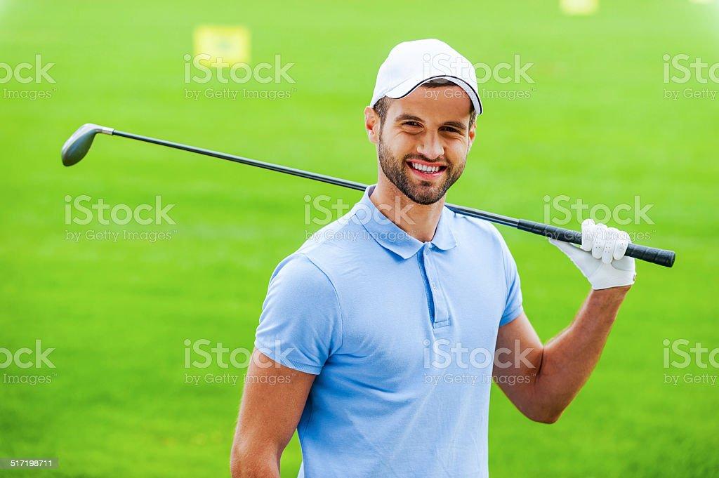 Confident golfer. stock photo