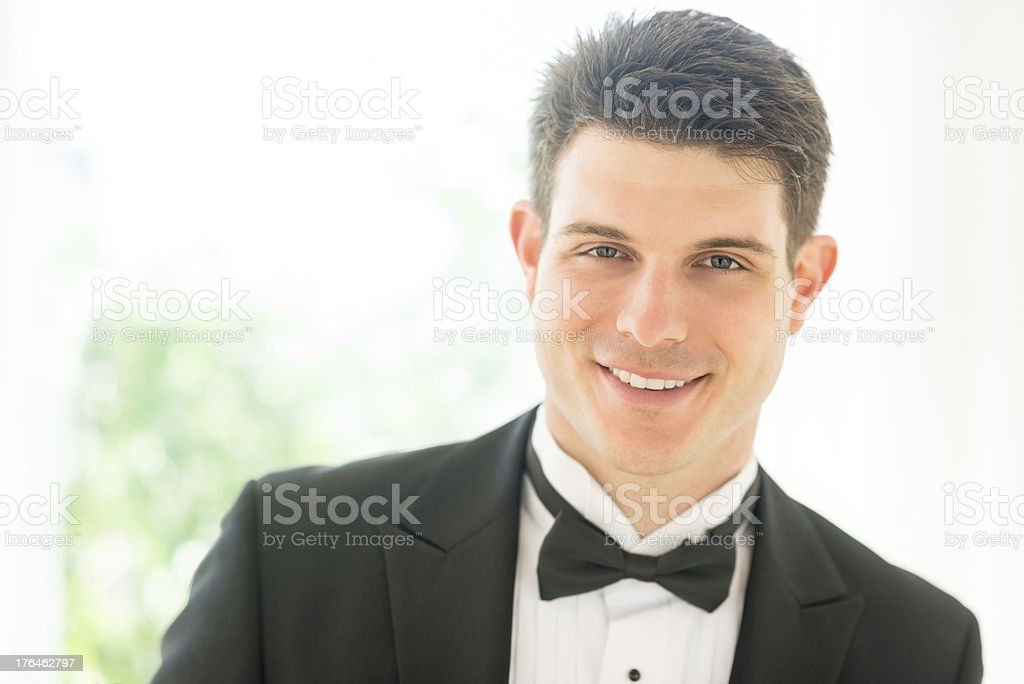 Confident Groom In Tuxedo Smiling royalty-free stock photo