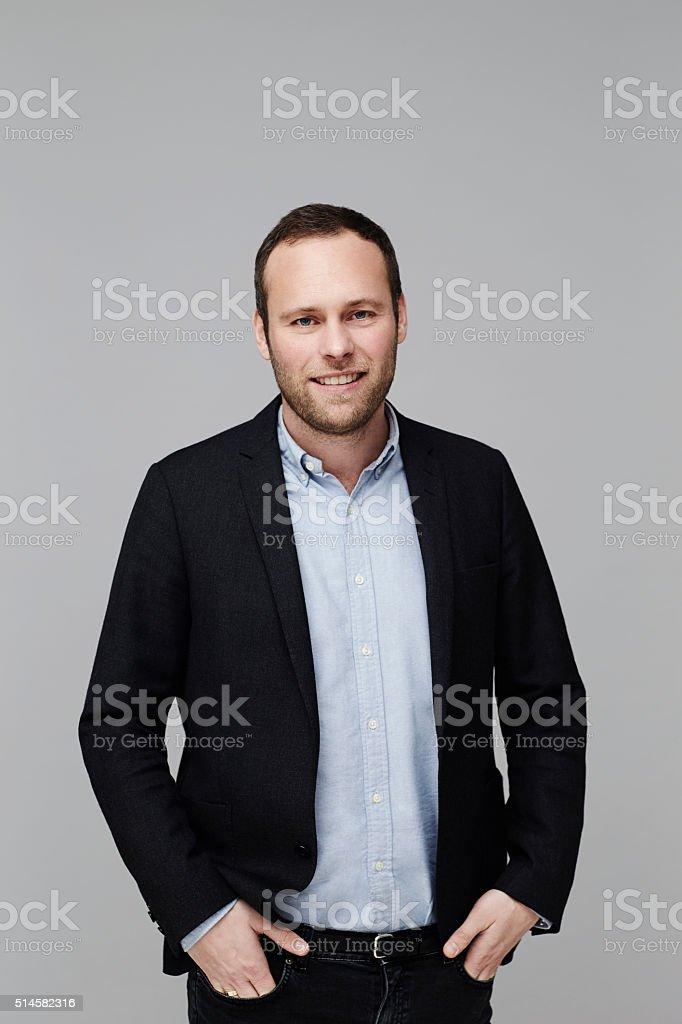 Confident guy in jacket, studio shot stock photo