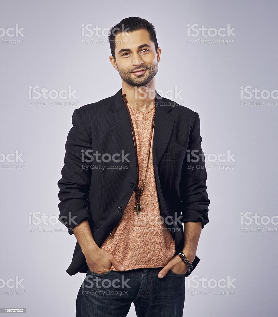 Confident Guy Smiling and Looking at You stock photo