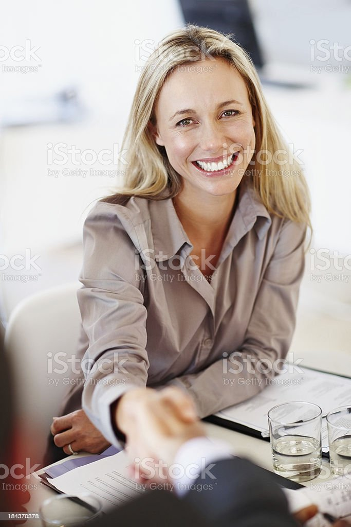 Confident handshake royalty-free stock photo