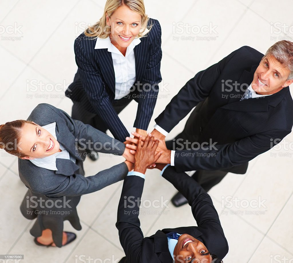 Confident happy business people with their hands together stock photo