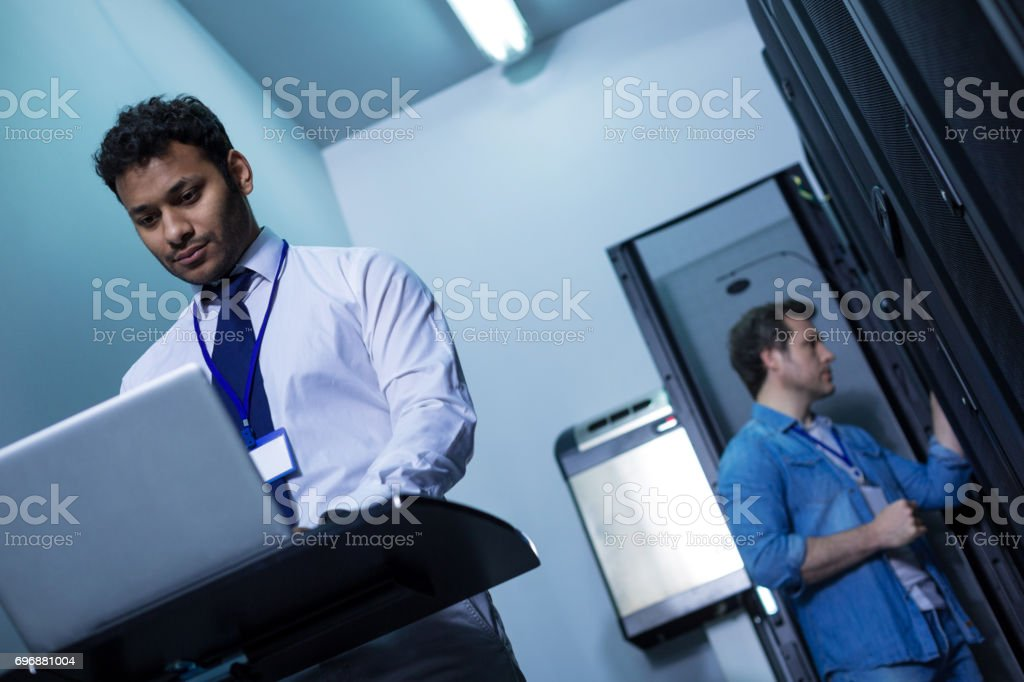 Confident hard working man using a laptop stock photo