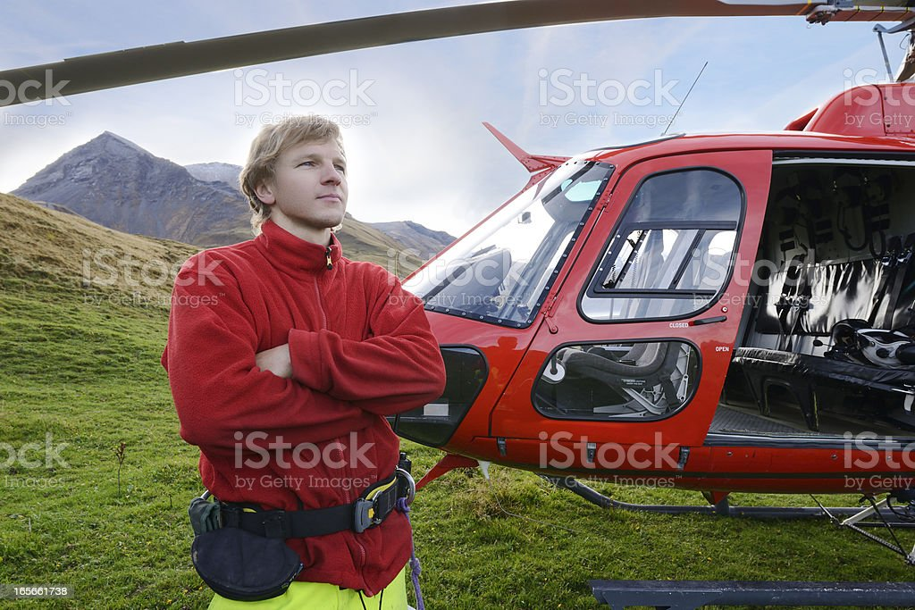 Confident Helicopter Pilot in Working in Alps Switzerland royalty-free stock photo