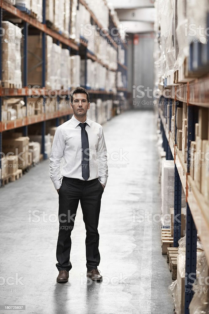 Confident his warehouse is in order royalty-free stock photo
