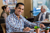 Confident Hispanic businessman works at his desk