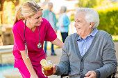 Confident home healthcare nurse visits with senior patient