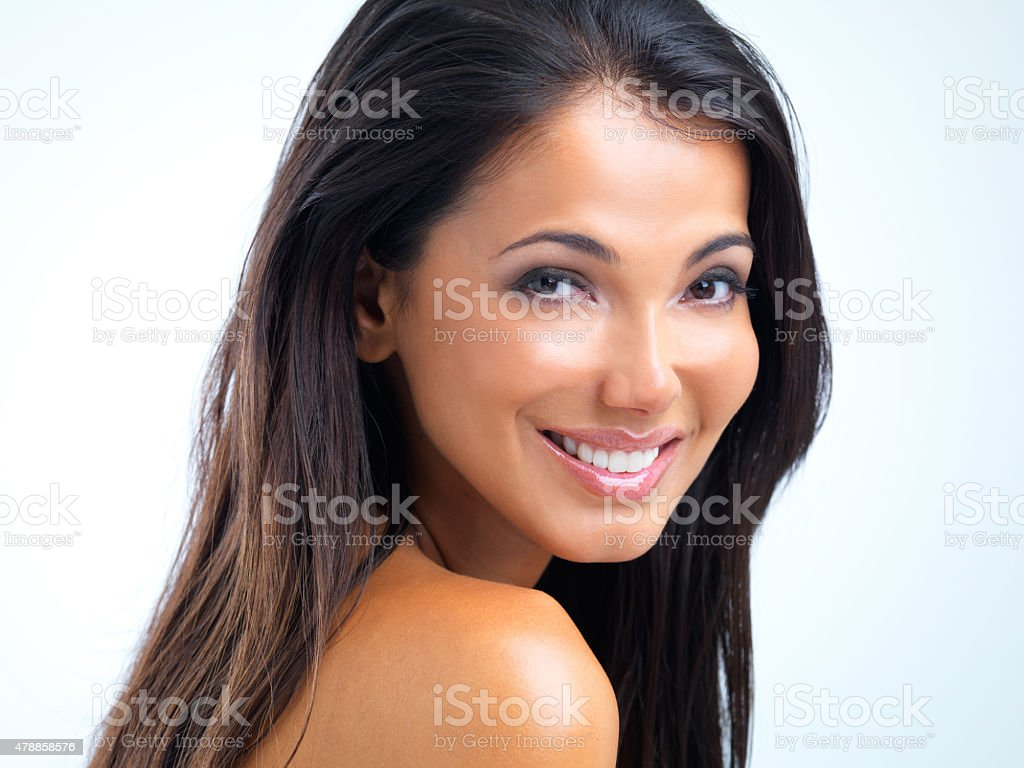 Confident in her enhanced beauty stock photo