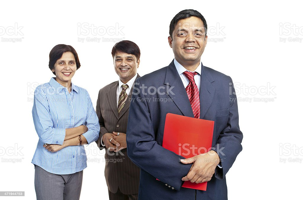 Confident Indian businessman with his team behind royalty-free stock photo